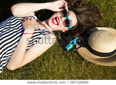 Bild Brünette Frau lange Haare tragen Strohhut Stock foto © deandrobot