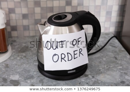 Out Of Order Text Stuck On Electrical Kettle Stock photo © AndreyPopov