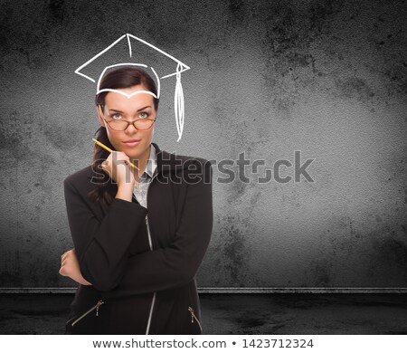 graduation cap drawn on head of young adult woman with pencil in stock photo © feverpitch