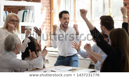 Happy successful enthusiastic business team Stock photo © Giulio_Fornasar