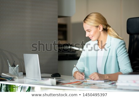 Young inspired designer watching educational video Stock photo © pressmaster