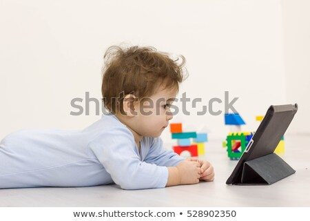 Baby Watching Cartoon On Tablet Stock photo © AndreyPopov