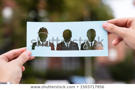 Stock photo: Hands Holding Paper With Cutout Career Choice