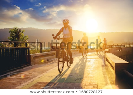 Stock photo: People cycling in row