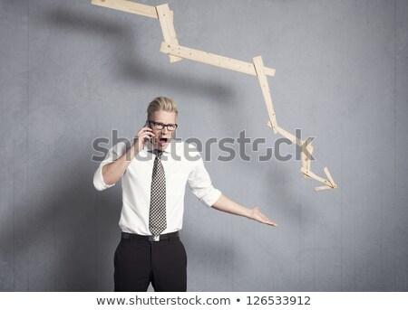 Woedend zakenman grafiek wijzend beneden business Stockfoto © lichtmeister