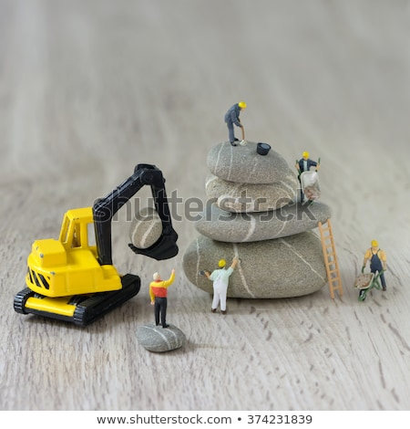 Construction worker operating the crawler excavator Stock photo © Kzenon