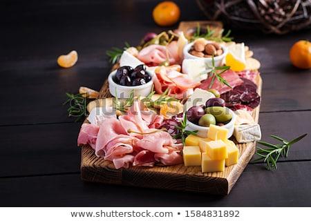 Salame antipasti legno top view Foto d'archivio © Alex9500