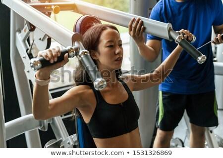 Egzersiz makine göğüs genç ağır ağırlık Stok fotoğraf © Jasminko