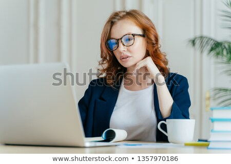Shot of atttactive businesswoman concentrated in monitor of laptop computer, has serious focused gaz Stock photo © vkstudio
