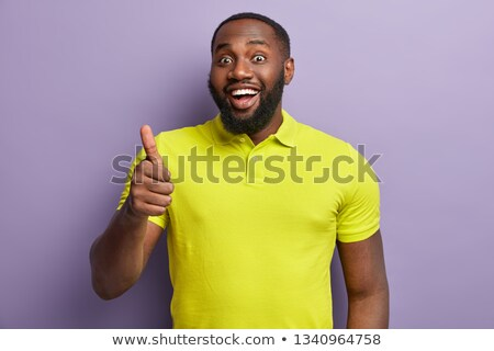 Positief glimlachend man stoppels duim omhoog Stockfoto © vkstudio
