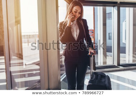 Tourist business woman leaving for trip on train with bag and luggage. Lady going on travel entering Stock photo © Maridav