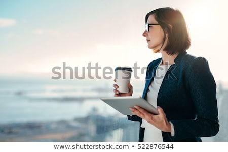 thinking business woman standing stock photo © maridav