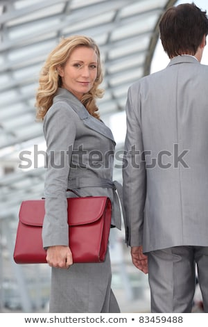 Woman carrying briefcase with colleague Stock photo © photography33