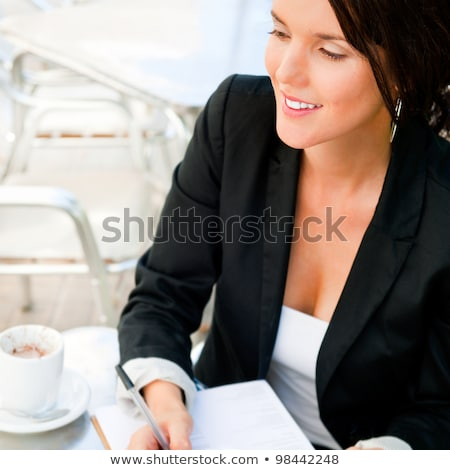 business woman working with documents while having lunch or brea stock photo © hasloo