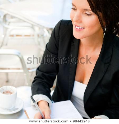 Business woman arbeiten Dokumente Mittagessen Frühstück Kaffee Stock foto © HASLOO