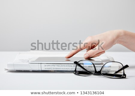 Woman in glasses reading a newspaper stock photo © photography33
