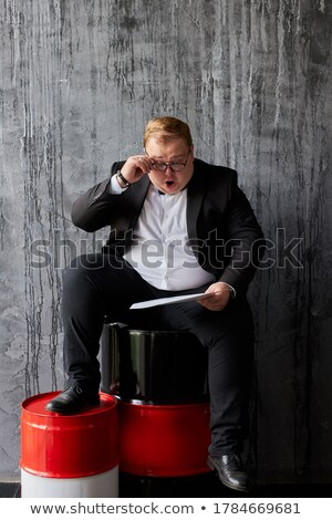 businessman showing metal container Stock photo © dolgachov