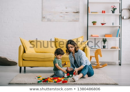 Mother and son with colourful building blocks Stock photo © photography33