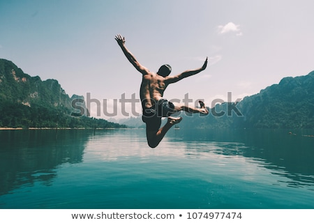 man jumping of joy on the beach stock photo © feedough