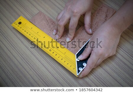 female woodworker measuring a board Stock photo © photography33