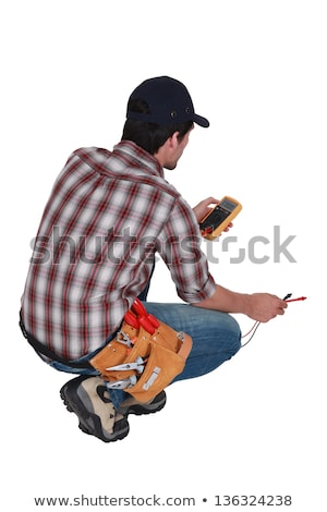 Electrician kneeling by voltmeter Stock photo © photography33