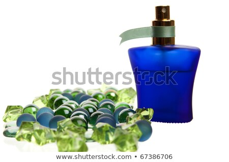Blue parfume bottle back lit Stock photo © shutswis