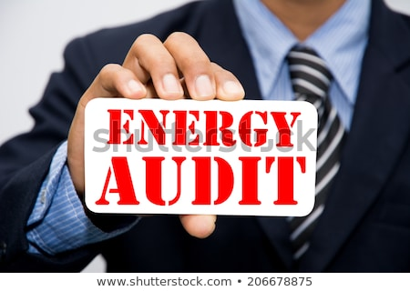 businessman holding an energy consumption label stock photo © photography33