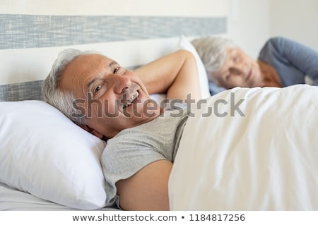 Couple laying peacefully in bed Stock photo © photography33