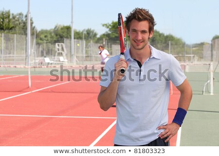 Man stood by tennis court Stock photo © photography33