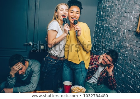 Woman enjoying loud music. Rock on Stock photo © stockyimages