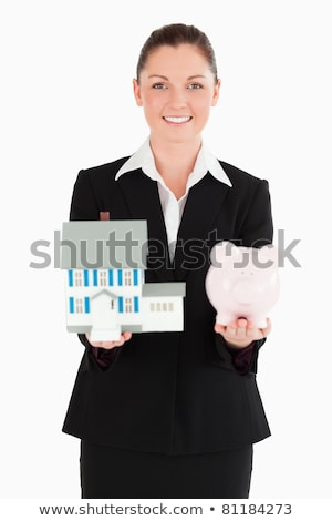 Bela mulher terno piggy bank miniatura casa Foto stock © wavebreak_media