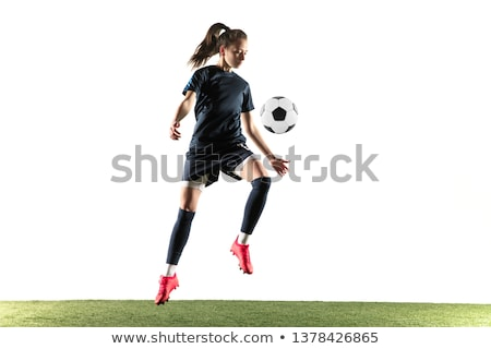 female soccer player posing with ball stock photo © dash