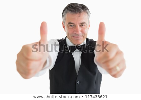 Glad waiter having thumbs up in front of camera Stock photo © wavebreak_media