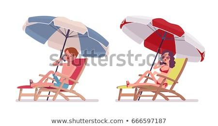 Chaise lounge under an umbrella on the beach Stock photo © Tatik22