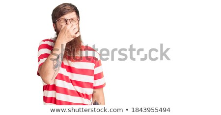 fashion young man with red nose is shocked Stock photo © feedough