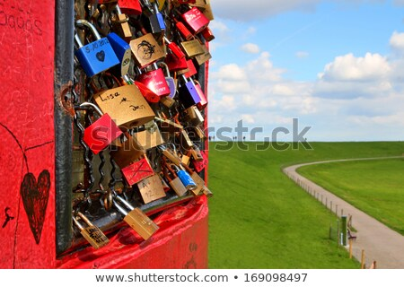 Padlocks on the grid of a lighthouse in Pilsum, Germany. Stock photo © richardjary