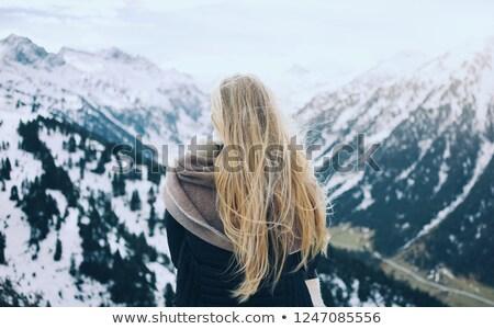 Blond woman enjoying the sun beams Stock photo © konradbak