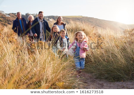 Family Walking Along Dunes On Winter Beach Stock photo © monkey_business