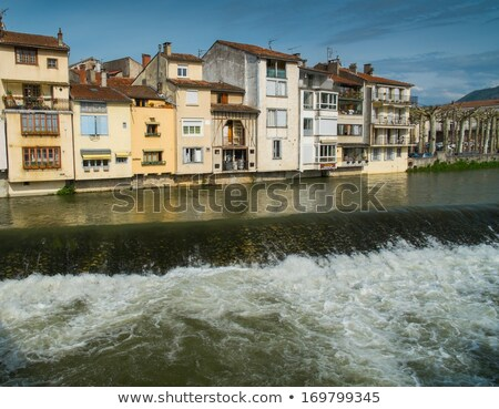 houses standing on embankment of salat river in saint girons town france stock photo © nejron