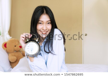 Young woman holding teddy bear and showing her hands Stock photo © bmonteny