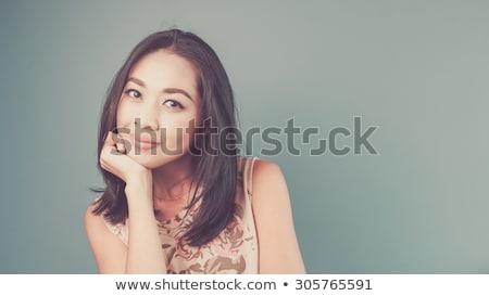 Pretty Vietnamese woman relaxing on the grass Stock photo © smithore