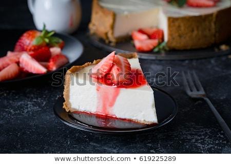 Cheese cake on black plate Stock photo © maxsol7