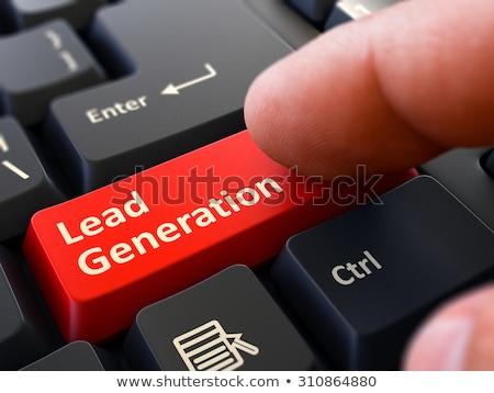 finger presses red keyboard button lead generation stock photo © tashatuvango