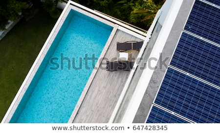 Vacation home. Solar panels on roof. Solar power Stock photo © orensila
