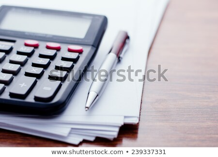 Close up calculator with pen Stock photo © punsayaporn