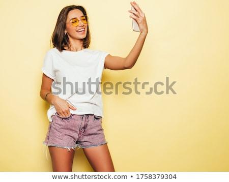 Moda foto sexy girl jeans alla moda giovani Foto d'archivio © NeonShot