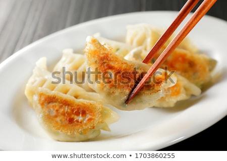 Pan frying pork and garlic Stock photo © Digifoodstock
