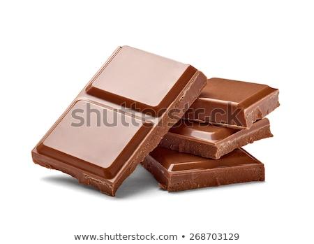 Csokoládé szelet közelkép izolált fehér csokoládé háttér Stock fotó © OleksandrO