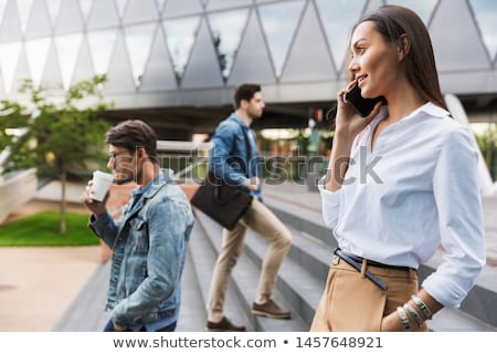 Сток-фото: деловая · женщина · ходьбе · вниз · улице · говорить · Smart