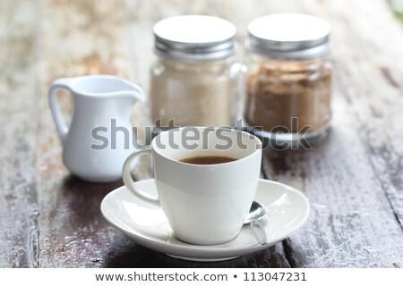 Croissant and glass of cafe latte on white plate Stock photo © rafalstachura